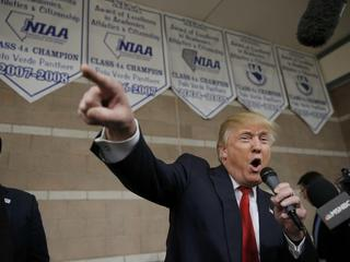 Republican U.S. presidential candidate Donald Trump addresses caucus goers as he visits a Nevada Rep