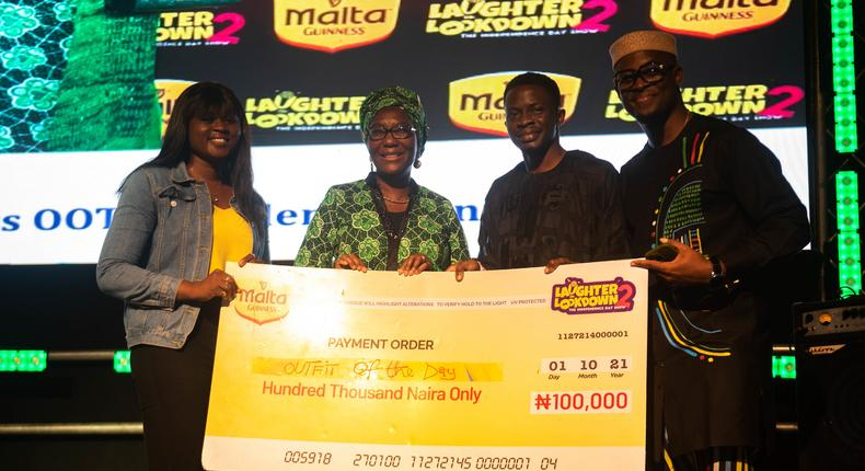 Winner of the Malta Guinness Out fit of the day challenge being rewarded with 100,000 Naira at Laughter on Lockdown 2021.