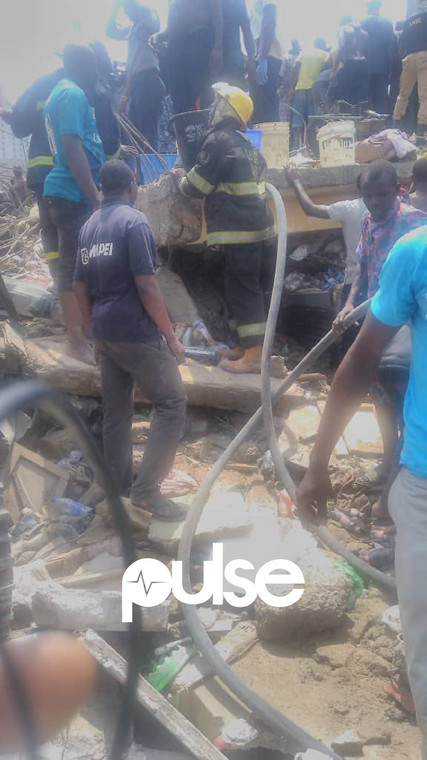 A Lagos State Emergency Agency (LASEMA) at the sight of the collapsed building (Pulse)