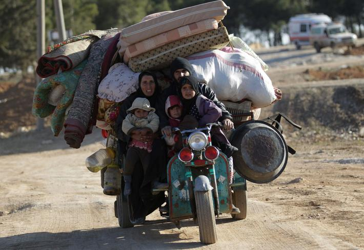 People who fled the violence from Islamic State-controlled northern Syrian town of al-Bab arrive in