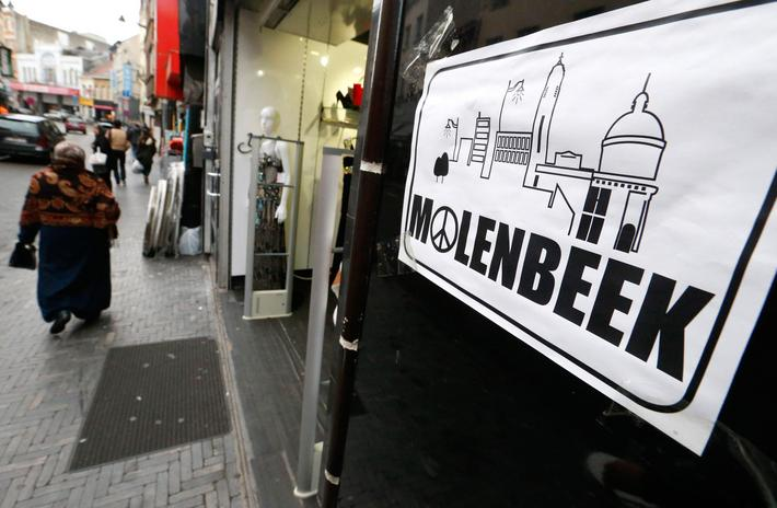 "File photo of a placard reading Molenbeek with a ""peace and love sign"" being seen on a shopping stre"