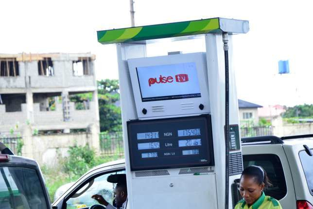 Pulse TV up-to-date news at a Forte oil fuel station in Lagos