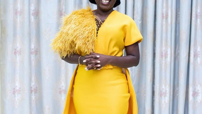 Gospel Singer, Diana Hamilton stuns in a yellow gown.
