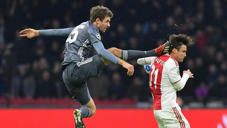 Bayern Munich striker Thomas Mueller is suspended for both legs of their Champions League last 16 matches against Liverpool for this kick on Ajax's Argentine defender Nicolas Tagliafico during December's 3-3 draw in Amsterdam in the group stages.