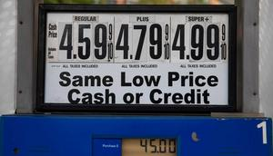 Gas prices are displayed at a gas station in New York, the United States, on Oct. 13, 2021