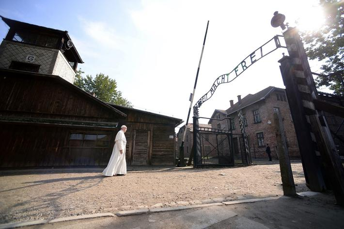 Pope Francis walks through Auschwitzs notorious gate during his visit to the former Nazi death camp
