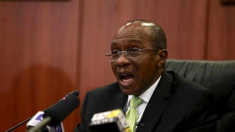 Governor Godwin Emefiele announces that Nigeria's central bank is keeping its benchmark interest rate on hold at 13 percent in Abuja, Nigeria, July 24, 2015. REUTERS/Afolabi Sotunde
