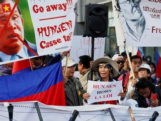 Protesters attend a protest against Cambodia's Prime Minister Hun Sen during the EU-Asia leaders sum