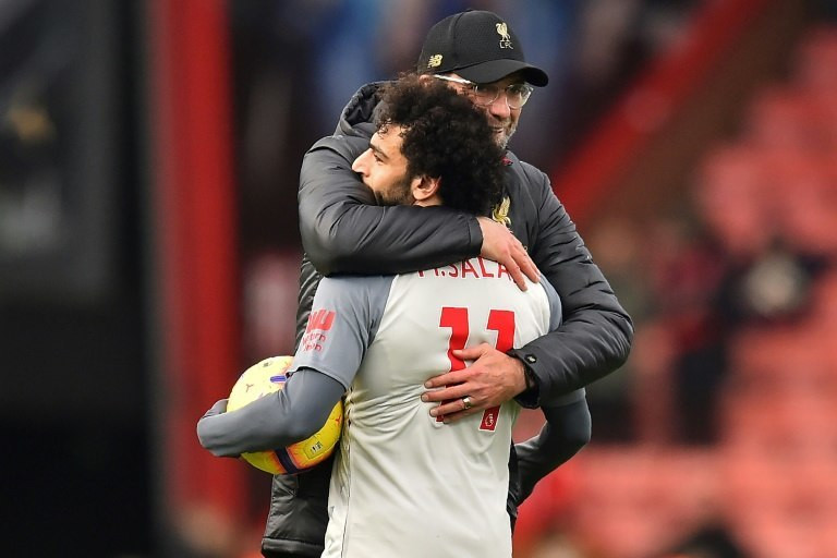 Liverpool forward Mohamed Salah holds the match ball after scoring a hat-trick against Bournemouth