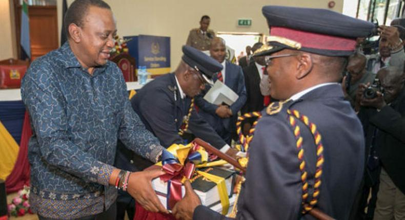 Former IG Joseph Boinnet with President Uhuru Kenyatta