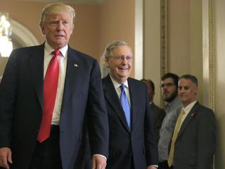 U.S. President-elect Donald Trump walks with Senate Majority Leader McConnell on Capitol Hill in Washington