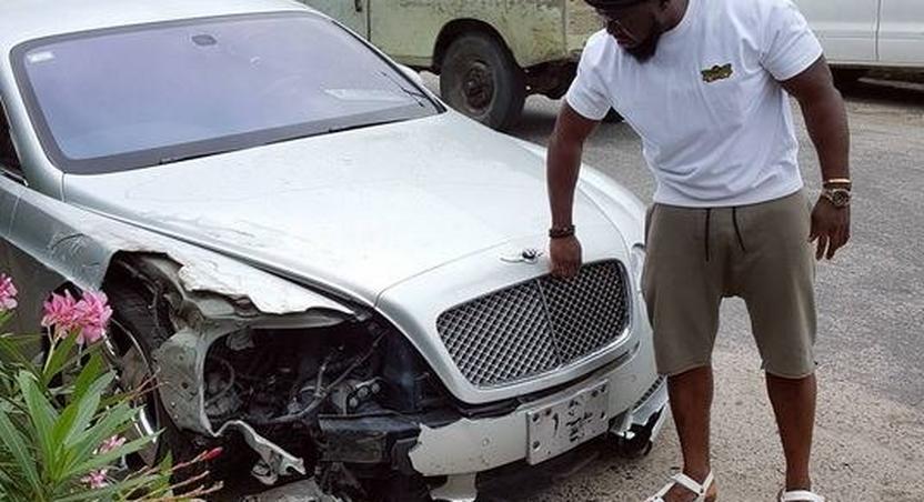 Timaya with his bashed Bentley