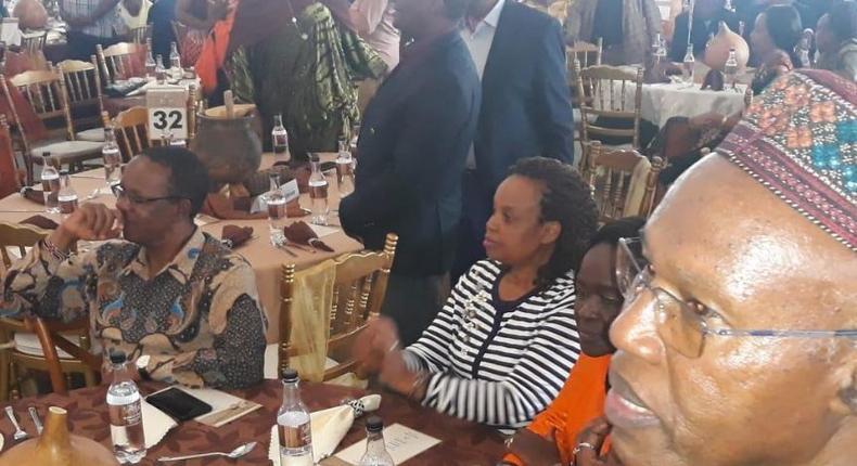 A file photo of Interior PS Karanja Kibicho (left) at Governor Anne Waiguru's wedding
