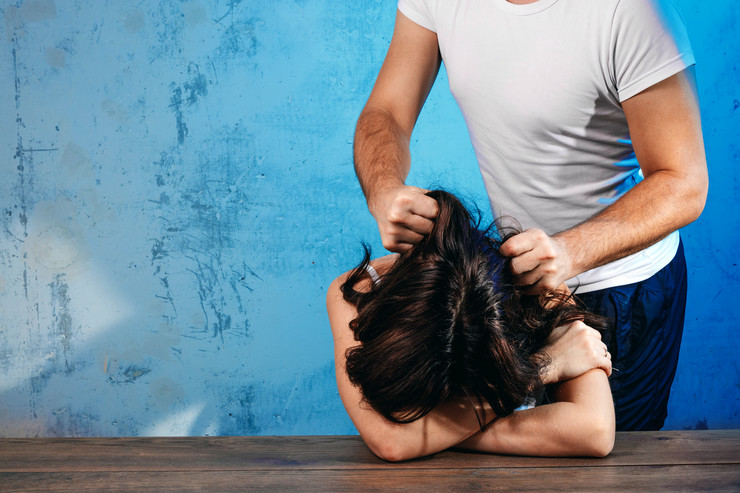 stock-photo-a-man-mocks-a-woman-against-a-blue-wall-concept-of-domestic-violence-domestic-beating-of-a-woman-746008729