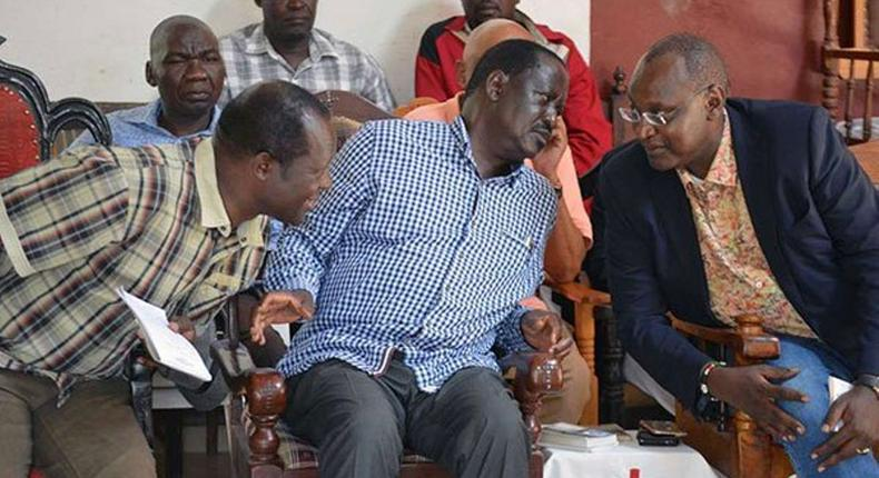 Jubilee Sec-Gen Raphael Tuju (L) AU Envoy Raila Odinga and Muhoho Kenyatta