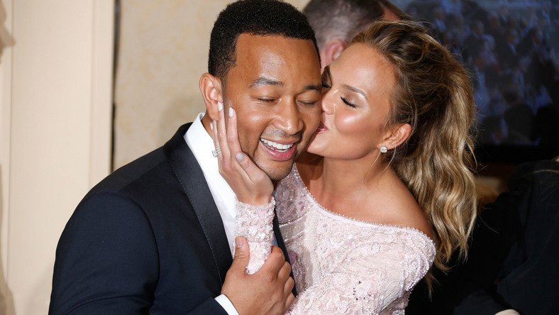 Chrissy Teigen and John Legend are a poster couple for PDA [Credit Getty]