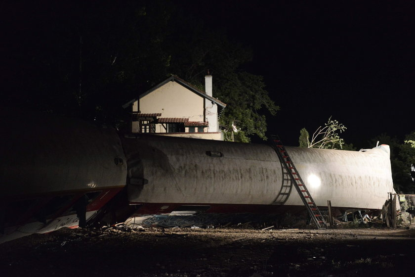 A derailed train carriage is seen toppled in the town of Adendro in northern Greece