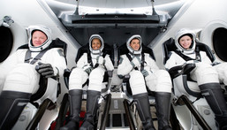 The Inspiration4 crew inside a model Crew Dragon spaceship. Left to right: Chris Sembroski, Sian Proctor, Jared Isaacman, and Hayley Arceneaux.