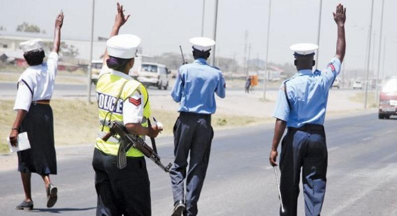 A police roadblock. Traffic Officers' open fire at EACC detectives
