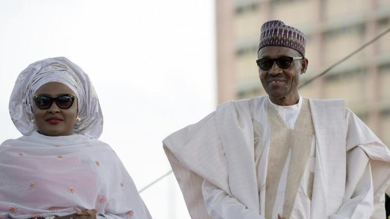 Nigerian President Mohammadu Buhari arrives with his wife Aisha, before taking oath of office at the Eagles Square in Abuja, on May 29, 2015