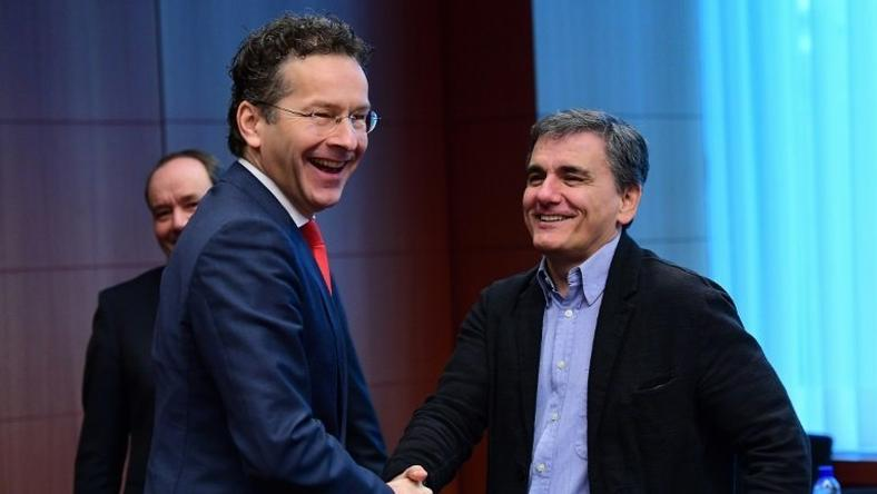 Eurogroup President and Dutch Finance Minister Jeroen Dijsselbloem (L) and Greece's Finance Minister Euclid Tsakalotos speak together ahead of a Eurogroup finance ministers meeting at the European Council in Brussels, on December 5, 2016