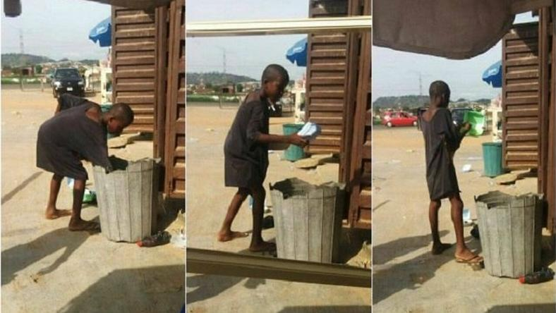 The hungry boy rummaging from a dustbin