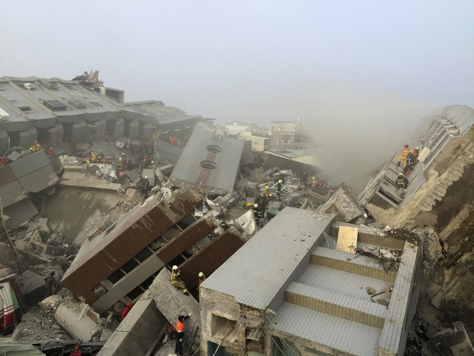 Rescue personnel work at the site where a 17-storey apartment building collapsed, after an earthquake in Tainan