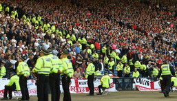 Lines of police separate rival England and Scotland supporters Creator: Paul ELLIS