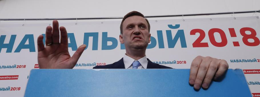 Russian opposition leader Alexei Navalny delivers a speech during a meeting to uphold his bid for pr