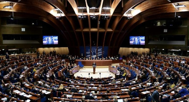 The move by the PACE, seen being addressed by French President Francois Hollande, marks an unprecedented step back for Turkey, which becomes the first of the group's 47 member states to be reinstated on monitoring due to worries over its governance