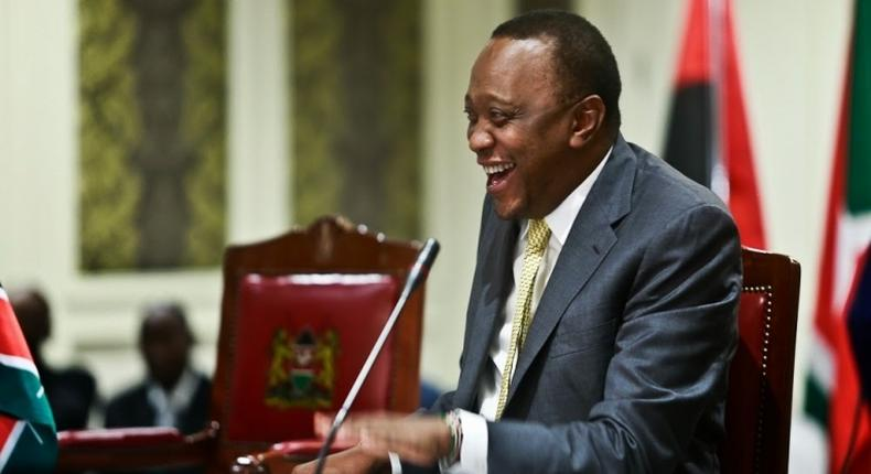 President Uhuru Kenyatta breaks into laughter during a past event