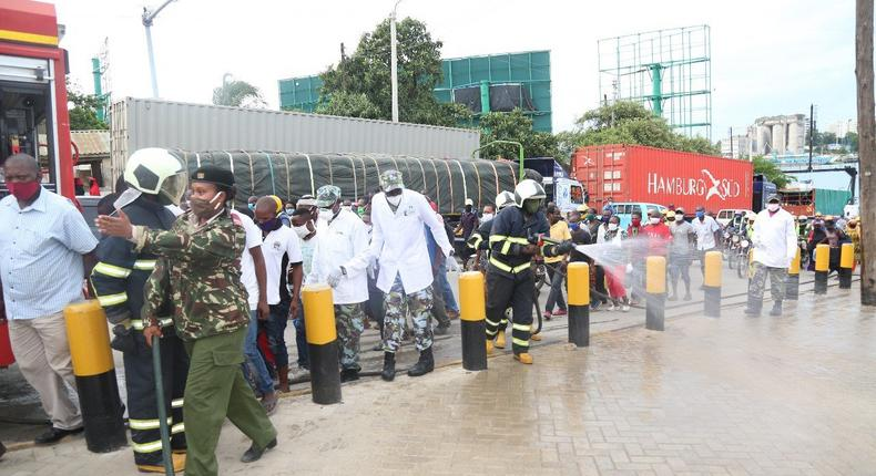 KDF soldiers with disinfection and crowd control at the Likoni Channel crossing