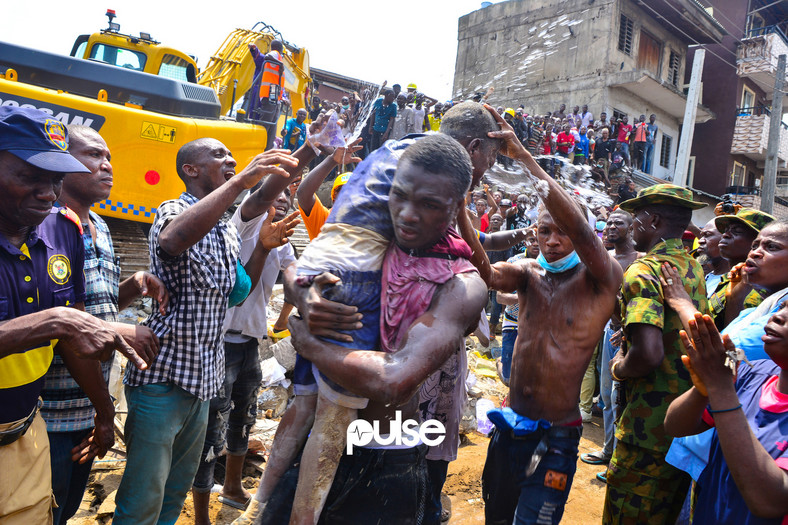 Water is poured on a school child after being rescued (Pulse)