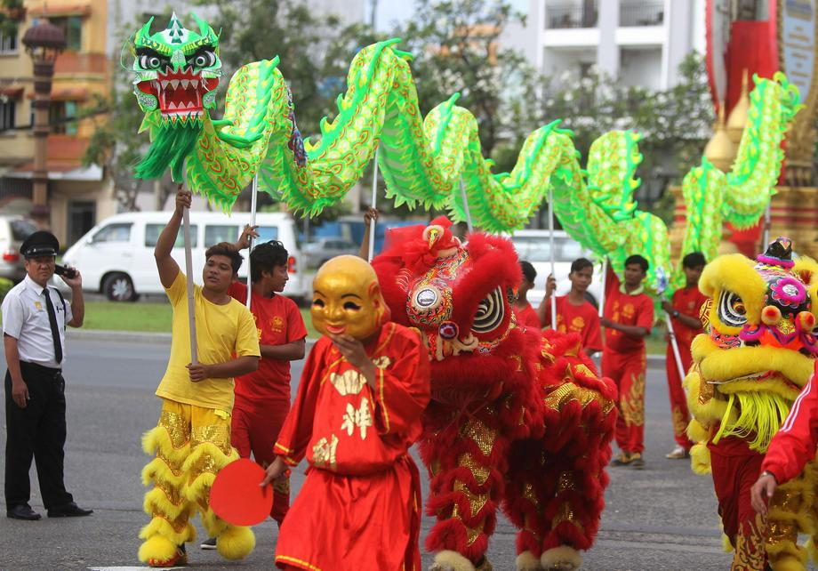 Men perform a dragon and lion dance ahead of the Chinese Lunar New Year in Phnom Penh