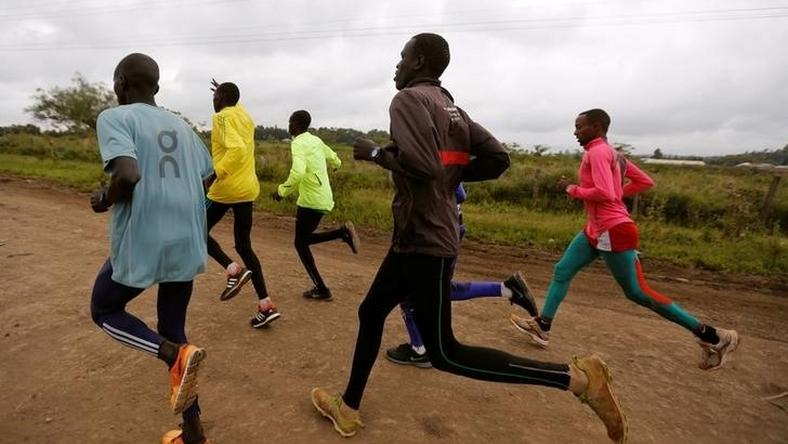 Athletes from South Sudan, part of the refugee athletes who qualified for the 2016 Rio Olympics, and their training partners run along a dusty road during a jogging session at their camp in Ngong township near Kenya's capital Nairobi, June 9, 2016.