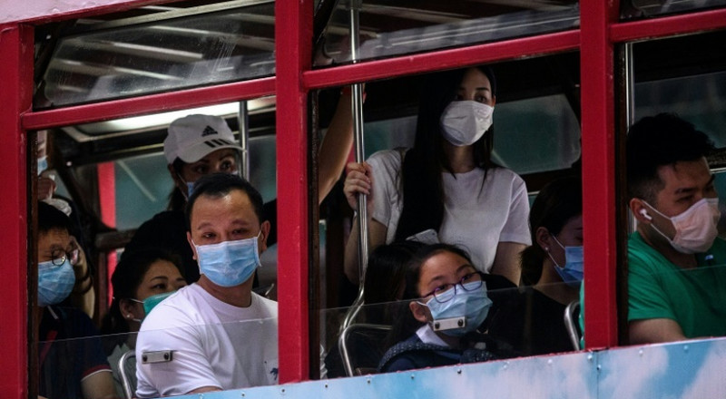 Hong Kong reimposes social distancing as virus cases spike