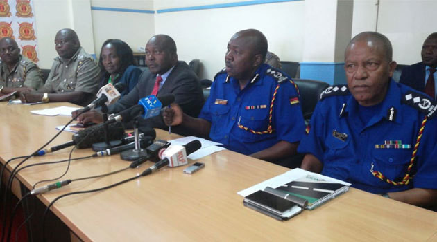 Police Spokesman Charles Owino with NTSA boss Francis Mejja during a press briefing on Wednesday