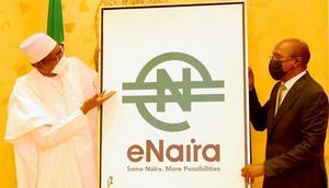 L-R: President Muhammadu Buhari; and CBN Governor, Godwin Emefiele at the launch of e-Naira [Presidency]