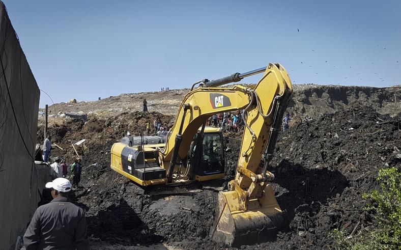 An excavator aids rescue efforts at the scene of a garbage landslide on the outskirts of Addis Ababa, Ethiopia.