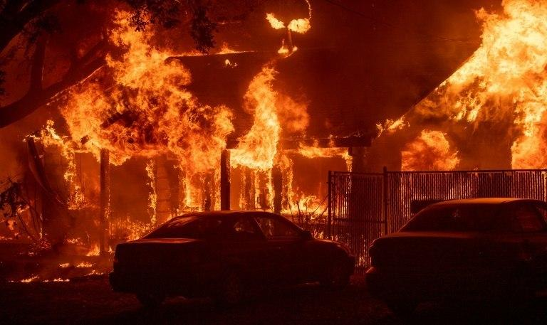 A home burns as a wildfire tears through the town of Paradise in northern California
