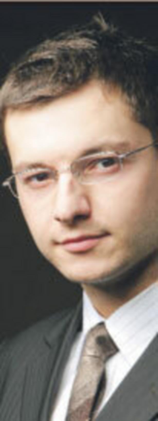 Grzegorz Skowroński, prawnik, Baker & McKenzie