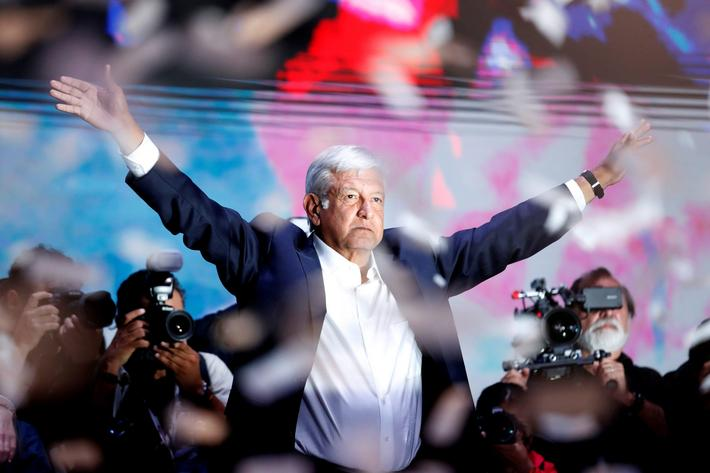 Presidential candidate Andres Manuel Lopez Obrador gestures as he addresses supporters after polls c