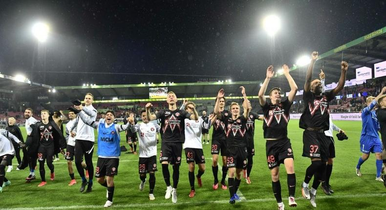 Danish delight: Midtjylland's players celebrate after defeating Celtic Creator: Bo Amstrup