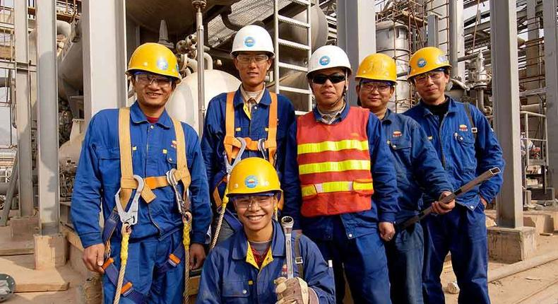 ___6909556___https:______static.pulse.com.gh___webservice___escenic___binary___6909556___2017___6___28___9___124628-bechtel-nanhai-petrochemical-plant-construction-workers-on-site-2004