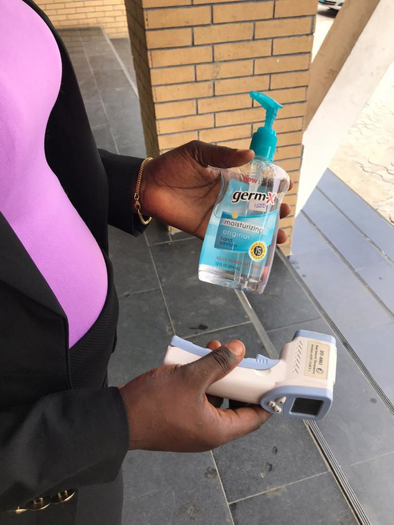 Hand sanitizer and temperature scanner at the Redeemed church in Okota, Isolo (Pulse)