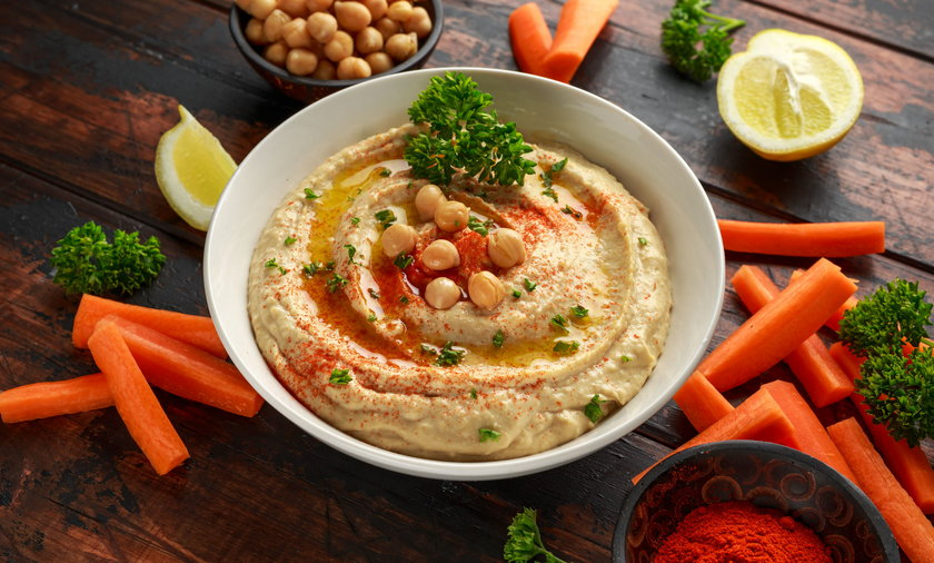 Hummus with olive oil, paprika, lemon and carrot.