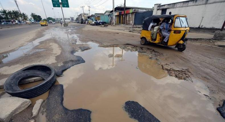 File photo: Picture depicting a pothole scene in Lagos (afp)