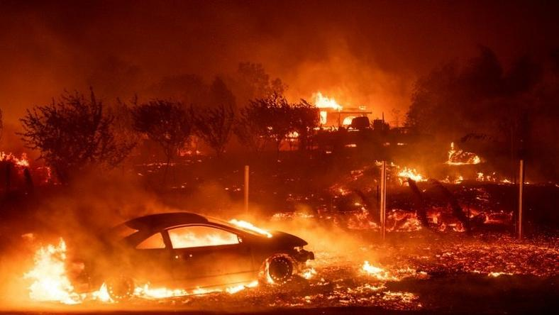 "Vehicles and homes have been destroyed by the ""Camp Fire"" in Paradise, California"