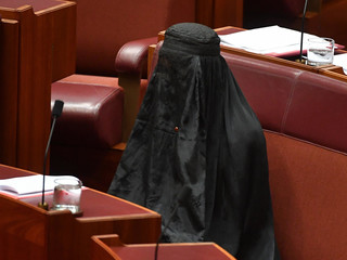 One Nation Leader Senator Pauline Hanson wears a full burqa at Parliament House in Canberra