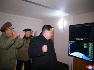 North Korea's leader Kim Jong Un is seen as the newly developed intercontinental ballistic rocket Hw